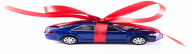blue car surprise with red ribbon